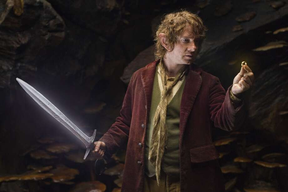 MARTIN FREEMAN as the Hobbit Bilbo Baggins with his sword, Sting, finds a small ring in Gollum's cave in the fantasy adventure THE HOBBIT: AN UNEXPECTED JOURNEY, a production of New Line Cinema and Metro-Goldwyn-Mayer Pictures (MGM), released by Warner Bros. Pictures and MGM.