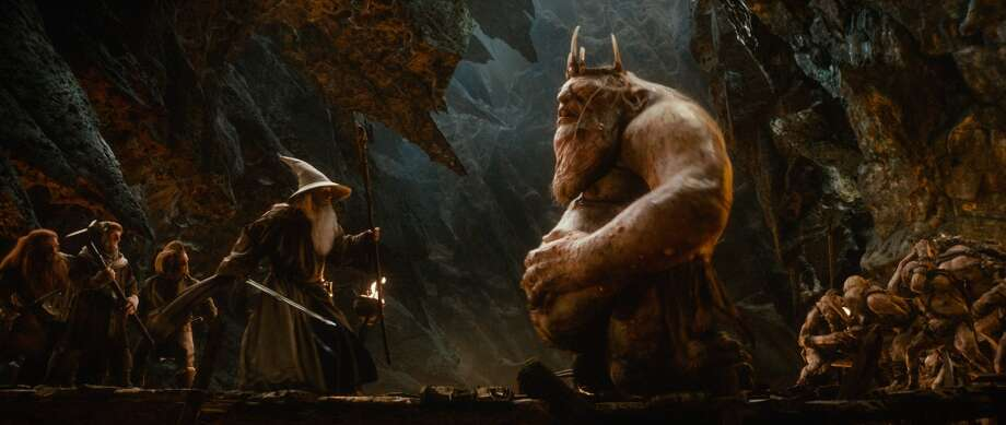 (L-r) PETER HAMBLETON as Gloin, Adam Brown as Ori, Jed Brophy as Nori, IAN McKELLEN (center) as Gandalf and the Great Goblin, performed by BARRY HUMPHRIES.