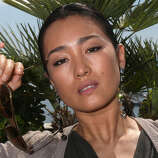 Gong Li during a photo session at the Cannes film festival on May 26, 2012.  A face that needs no adornment.