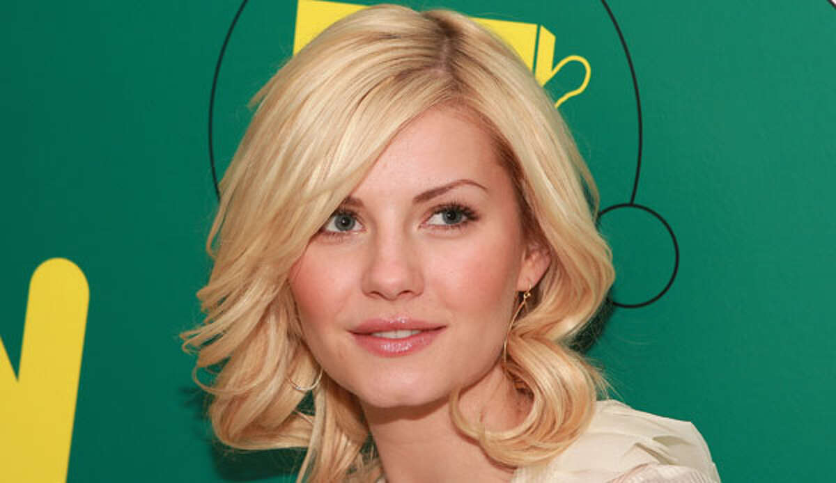"""""""Happy Endings"""" darling Elisha Cuthbert is a dead ringer for illustrations of the classic Nancy Drew character."""