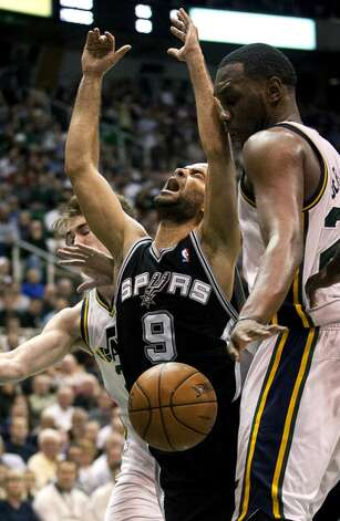 San Antonio Spurs guard Tony Parker (9), of France, loses possession of the ball under the hoop against the Utah Jazz during their NBA basketball game on Wednesday, Dec. 12, 2012, in Salt Lake City. The Jazz defeated the Spurs 99-96.  (Ben Brewer / The Deseret News)