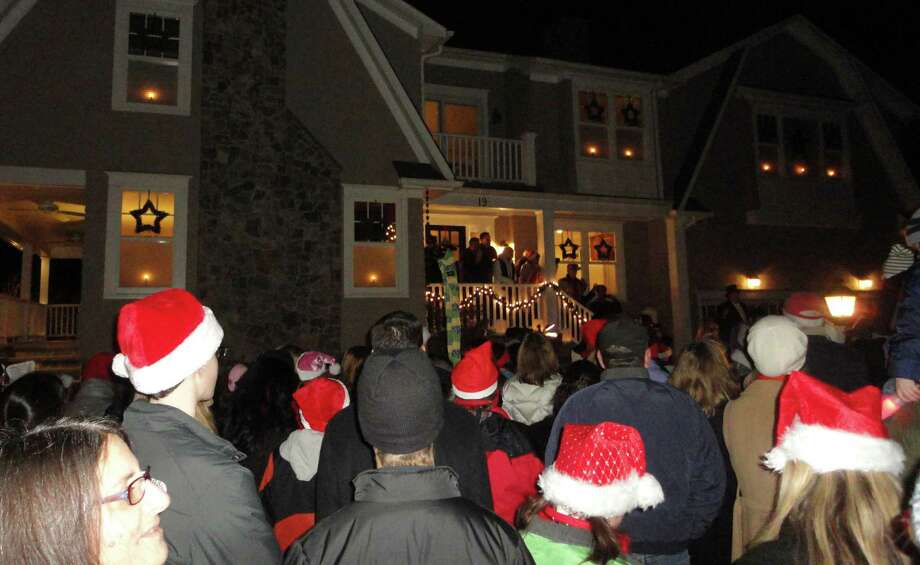 More than 500 Christmas carolers from the One Voice group of the Unitarian Church set the world record Wednesday night for mass door-to-door caroling.  Westport CT 12/12/12 Photo: Meg Barone / Westport News freelance