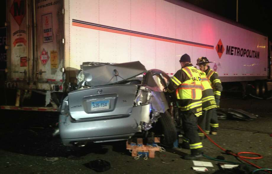 The driver of this Nissan Sentra was killed late Wednesday after colliding with a tractor-trailer truck late Wednesday at the southbound Interstate 95 rest stop in Fairfield.  Fairfield CT 12/12/12 Photo: Fairfield Fire Department / Fairfield Citizen contributed