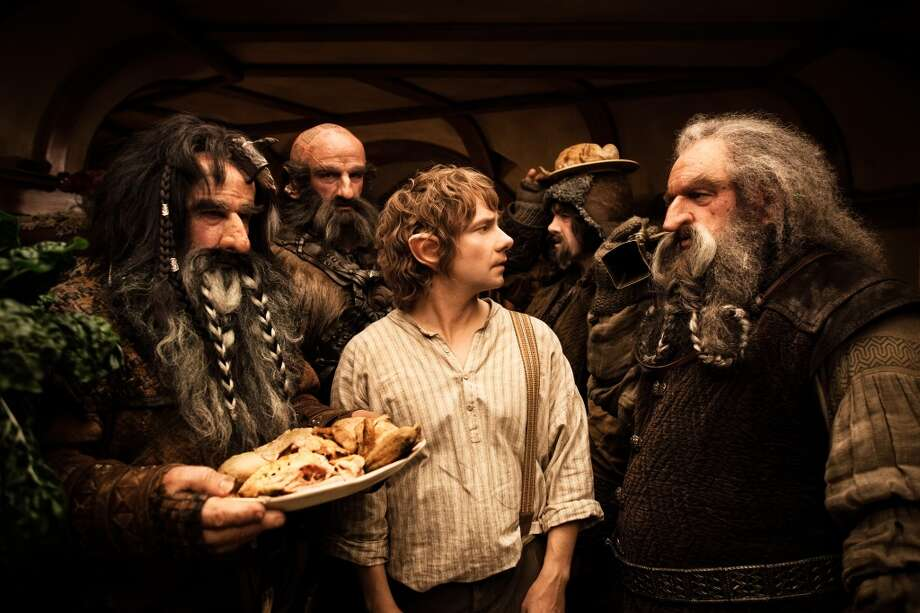 "Answer 6a. 6 meals a day (if they can get them) is mentioned in the prologue to ""The Fellowship of the Ring""Here, WILLIAM KIRCHER as Bifur, GRAHAM McTAVISH as Dwalin, MARTIN FREEMAN as Bilbo Baggins, JAMES NESBITT as Bofur and JOHN CALLEN as Oin share some food in €œTHE HOBBIT: AN UNEXPECTED JOURNEY. (MGM)"