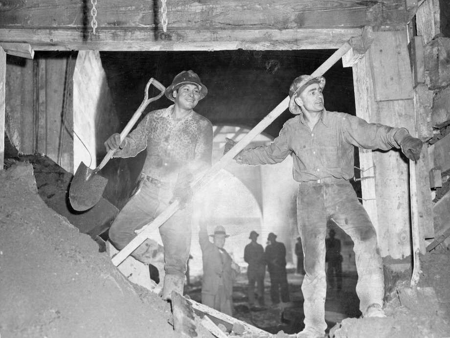 BROADWAY TUNNEL, June 6, 1952: Tunnel workers Fred Brown and John Korobi after the Broadway Tunnel breakthrough. Initial estimates were under $6 million, but the construction company went nearly $2 million over budget. Photo: Barney Peterson, The Chronicle / ONLINE_YES