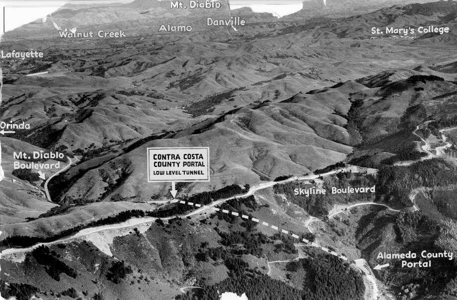 CALDECOTT TUNNEL, Dec. 5, 1937: A Chronicle graphic of the Caldecott Tunnel before it opened. This aerial view shows both sides of the grade. Articles said the two mile tunnel shaved more than 30 minutes off the commute. (Commercial Photo & View Co.) Photo: Photo: Commercial And Photo View / ONLINE_YES