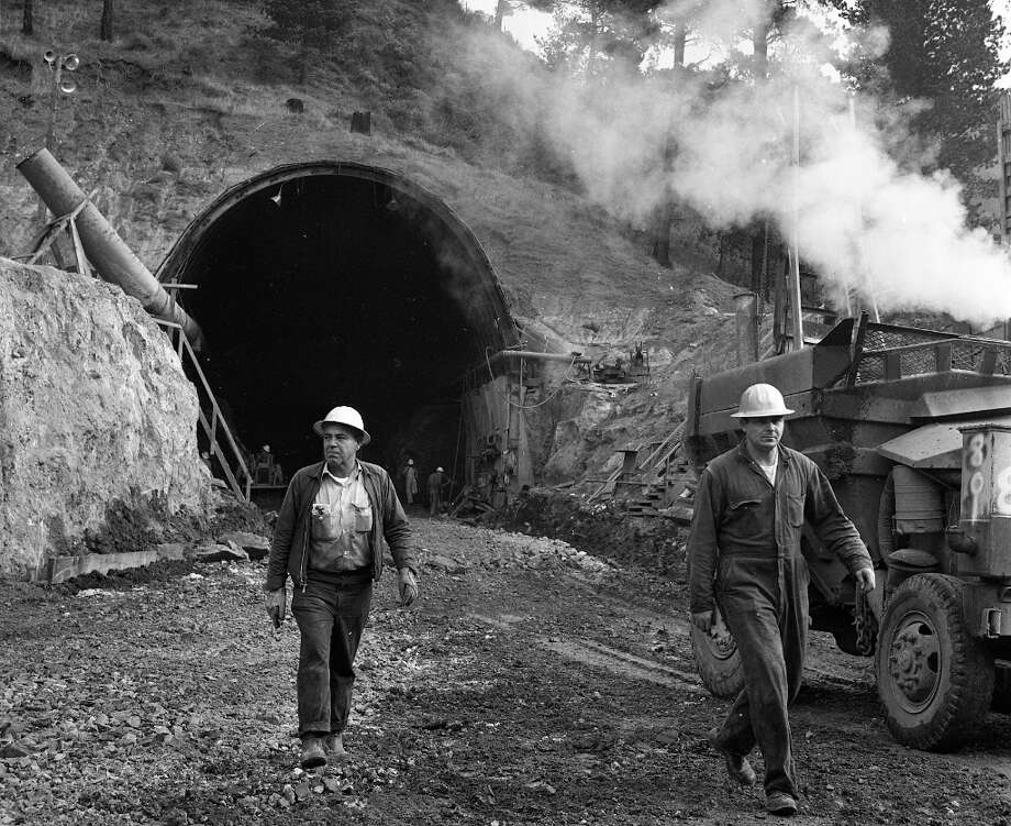 CALDECOTT TUNNEL, Jan. 10, 1963: The third bore of the Caldecott was finished in the 1960s. These workers are figuring out a way for the third bore to always be going the other way when I'm heading to Contra Costa County. Photo: Art Frisch, The Chronicle / ONLINE_YES