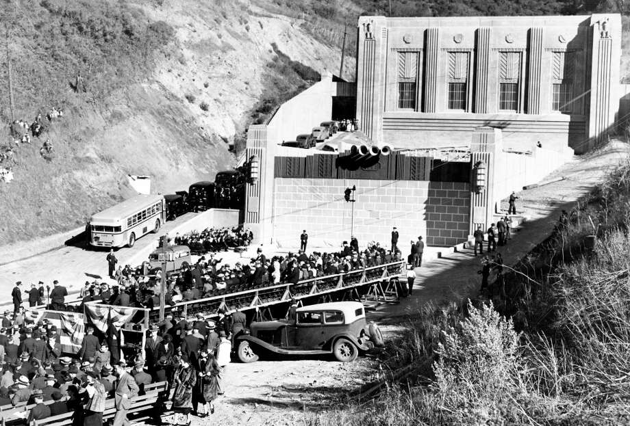 CALDECOTT TUNNEL, Dec. 6, 1937: Politicians, journalists and others wait for the ceremonial opening of the Caldecott Tunnel, which appeared to be the inspiration for Pink Floyd: The Wall. Those bricks are made out of paper mache. (Chronicle file) Photo: Chronicle File, The Chronicle / ONLINE_YES