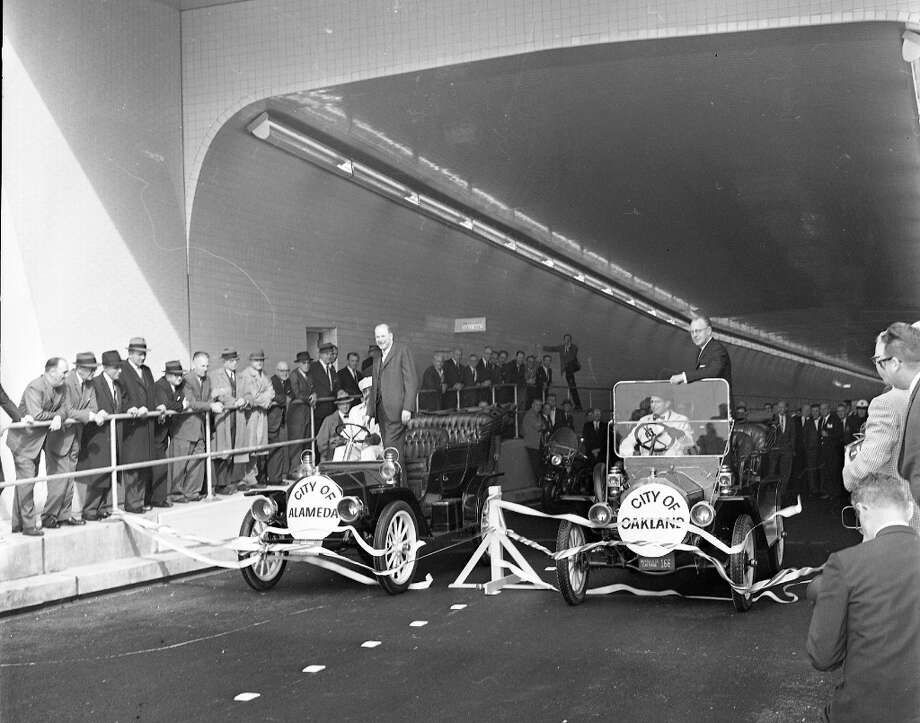 WEBSTER TUBE, April 3, 1963: Two cars break through finish lines to christen the Webster St. Tunnel between Oakland and Alameda. Photo: Joe Rosenthal, The Chronicle / ONLINE_YES
