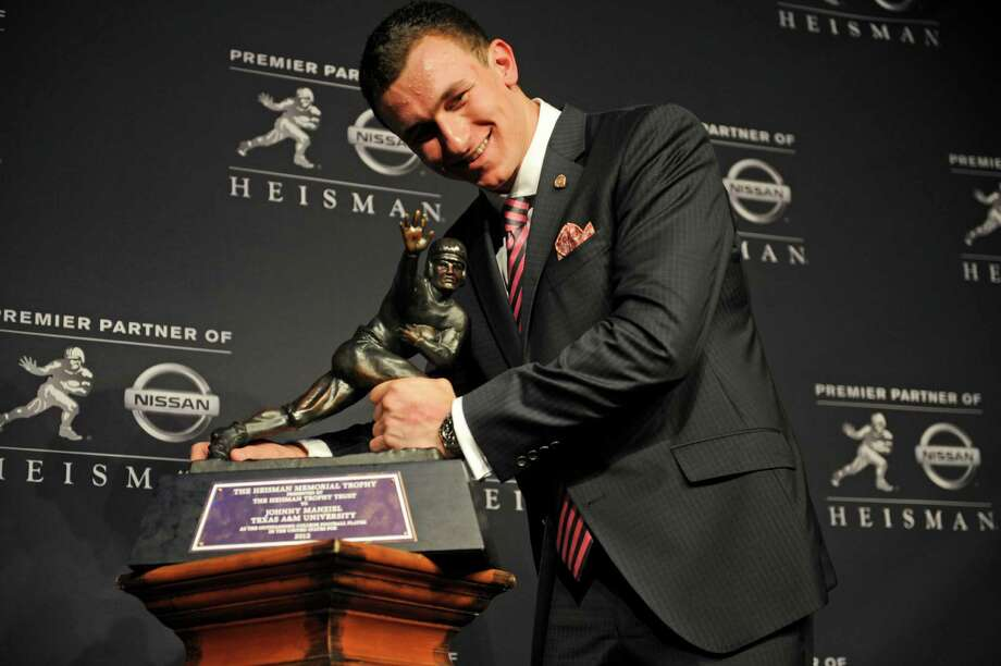 After leading Texas A&M to a stunning upset of undefeated defending national champion Alabama in Tuscaloosa, quarterback Johnny Manziel -- better known as Johnny Football -- becomes a household name. The Pride of Kerrville goes on to become the first freshman to win the Heisman Trophy. Photo: Henny Ray Abrams, Associated Press / FR151332 AP