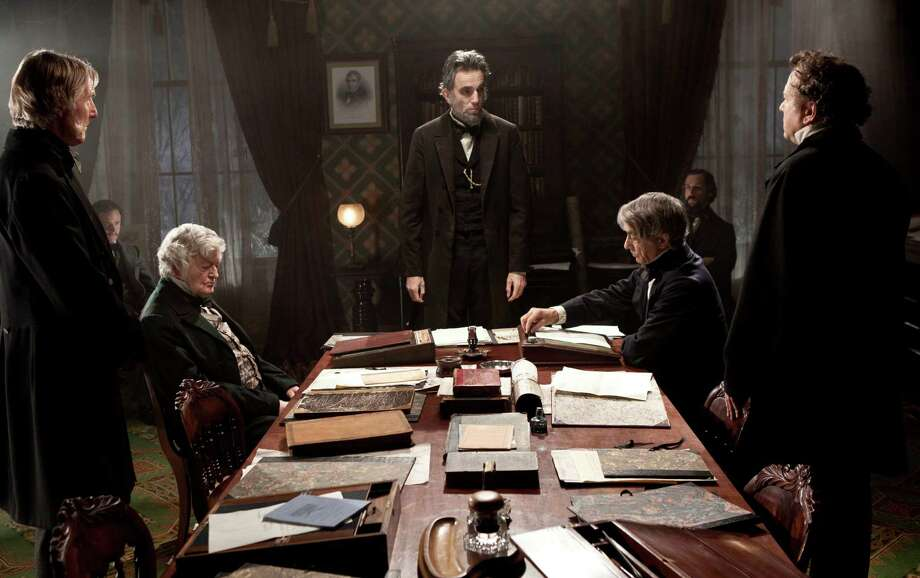"FILE - This undated publicity photo released by DreamWorks and Twentieth Century Fox shows, Daniel Day-Lewis, center rear, as Abraham Lincoln, in a scene from the film, ""Lincoln."" The film was nominated for a Golden Globe for best drama on Thursday, Dec. 13, 2012. Daniel Day Lewis was also nominated for best actor. The 70th annual Golden Globe Awards will be held on Jan. 13.  (AP Photo/DreamWorks, Twentieth Century Fox, David James, File) Photo: David James"