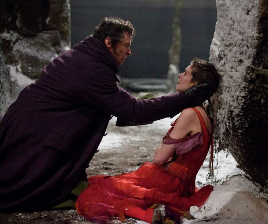 "This film image released by Universal Pictures shows Hugh Jackman as Jean Valjean, left, and Anne Hathaway as Fantine in a scene from ""Les Miserables.""  The film was nominated for a Golden Globe for best musical or comedy on Thursday, Dec. 13, 2012. The 70th annual Golden Globe Awards will be held on Jan. 13. (AP Photo/Universal Pictures) Photo: Uncredited"
