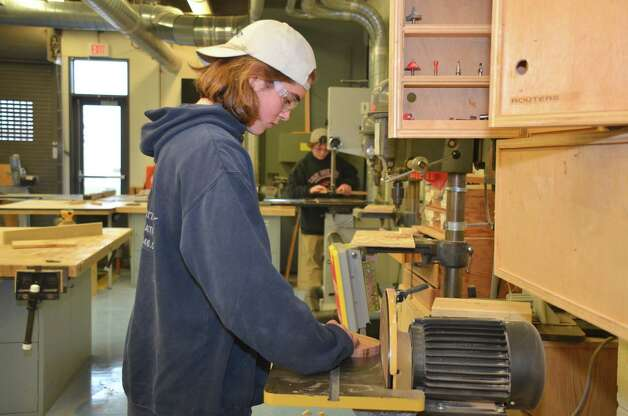 Freshman Will Allam uses the sander while making a skateboard.  Darien High School, Dec. 10, 2012. Photo: Jeanna Petersen Shepard