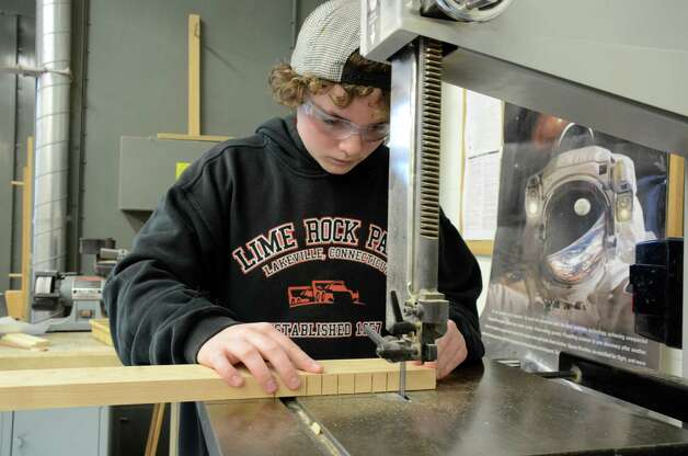 Freshman Ewan Johnson uses the bandsaw while working on a movie prop. Darien High School, Dec. 10, 2012. Photo: Jeanna Petersen Shepard