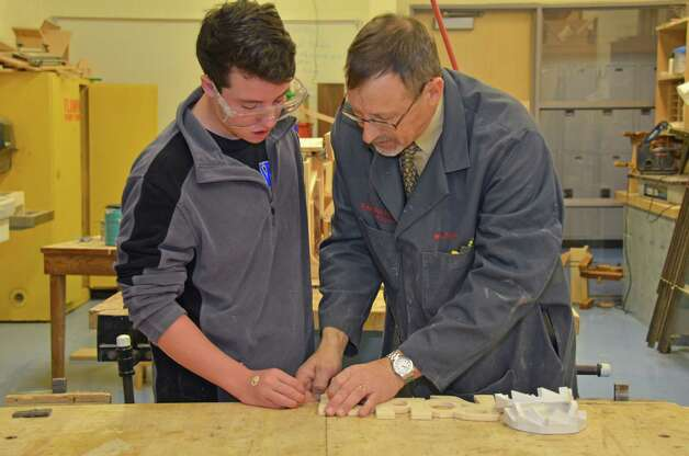 Teacher and Tech Ed Dept head Leon Strecker helps Robby Waters with his nameplate in woodworking class.  Darien High School, Dec. 10, 2012. Photo: Jeanna Petersen Shepard