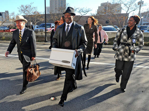 Calvin Walker walks toward the Jack Brooks Federal Courthouse Wednesday after a judge sentenced him to five years probation, a $660,000 fine and the 37 criminal charges he faced were dropped. Walker will also be allowed to continue working for Beaumont and Port Arthur Independent School Districts. Walker admitted in July to failing to pay federal income tax in a timely manner. Photo taken Wednesday, December 12, 2012 Guiseppe Barranco/The Enterprise Photo: Guiseppe Barranco, STAFF PHOTOGRAPHER / The Beaumont Enterprise