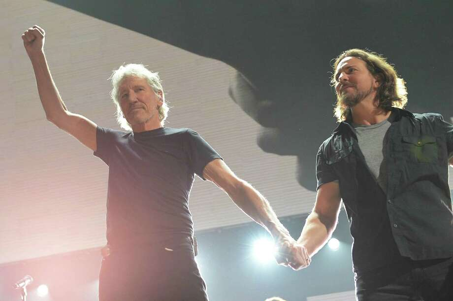 Roger Waters and Eddie Vedder take a bow.  (Photo by Larry Busacca/Getty Images for Clear Channel) Photo: Larry Busacca, Ap/getty / 2012 Getty Images