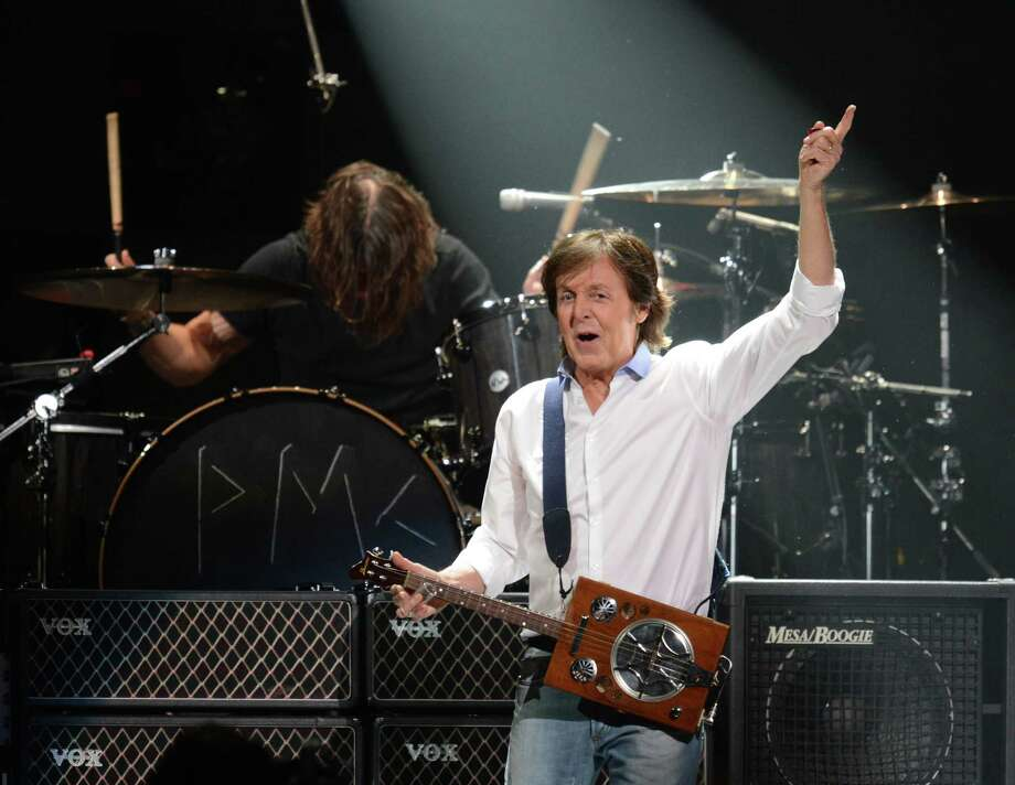 Paul McCartney performs. ( DON EMMERT/AFP/Getty Images) Photo: DON EMMERT, Ap/getty / 2012 AFP