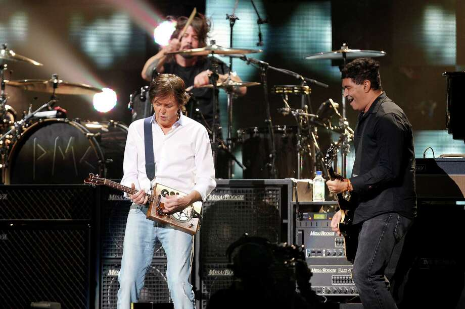 "No time for ""Love Me Do"" as Paul McCartney, performs with Dave Grohl, and  Pat Smear of Nirvana at the 12-12-12 The Concert for Sandy Relief at Madison Square Garden in New York on Wednesday. (AP Photo/Starpix, Dave Allocca) Photo: Ap/getty"
