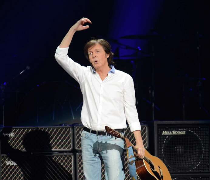 Paul McCartney arrives on stage.  (DON EMMERT/AFP/Getty Images)