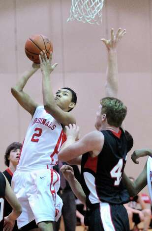 At left, CJ Byrd, (# 2) of Greenwich, scores during the boys high school basketball game between Greenwich HIgh School and Fairfield Warde High School at Greenwich High School, Wednesday night, Dec. 12, 2012. Photo: Bob Luckey / Greenwich Time