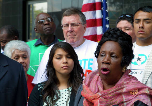 Congresswoman Sheila Jackson Lee speaks as she stands with officials and voters of the community during a press conference in front of the Federal Courthouse Monday, Nov. 5, 2012, in Houston. Lee held the press conference to inform the public about the voting process in Harris County and the state of Texas, such as where to vote and who to call to get additional information. Photo: Cody Duty, Houston Chronicle / © 2012 Houston Chronicle