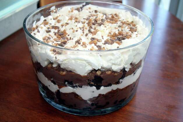 Death by Chocolate is a decadent dessert that combines chocolate, toffee, coffee liqueur, crumbled brownies and whipped topping. Just the name alone makes this a perfect dessert for an end-of-the-world party. Photo: Recipe Courtesy Allrecipes.com