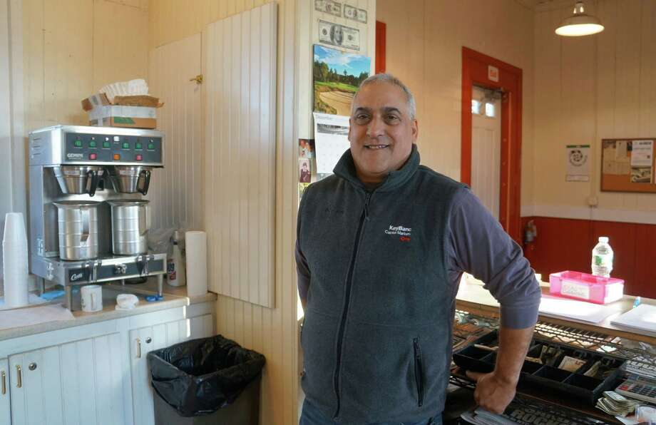 George Russo runs the Green's Farms C&P coffee concession at the Green's Farms Metro-North train station. Photo: Paul Schott / Westport News