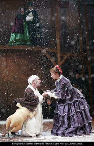 "Bill Raymond as Ebenezer and Michelle Hendrick as Belle in ""A Christmas Carol"" at Hartford Stage through Dec. 29. Photo: Contributed Photo / Connecticut Post Contributed"