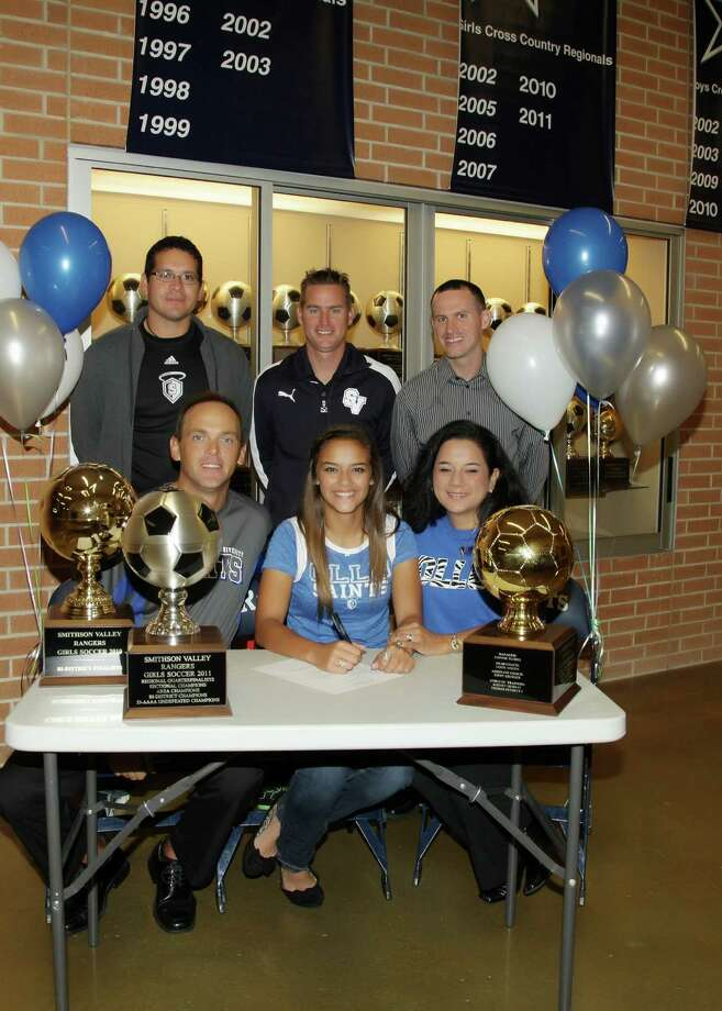 Smithson Valley High senior Pauline Fields signed her letter of intent Dec. 7 to play soccer at Our Lady of the Lake University. Pictured in the front row (l-r) are her father, Michael Fields, Fields and her mother Lisa. In the back row are Our Lady of the Lake soccer coach Arthur Salazar, SVHS girls soccer coach Jason Adkins and club soccer coach Robbie Babcock. Photo: Sam Roberts