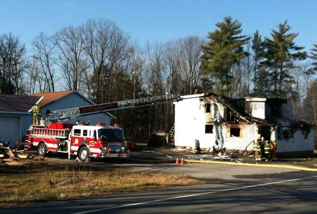 A fire at 2042 Route 9 in Jonesville, N.Y., destroyed a residence adjacent to a business. (Skip Dickstein/Times Union)