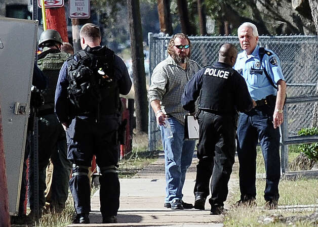Port Arthur police officers have arrested a man after a standoff that lasted nearly nine hours.  The man locked himself inside the home on 61st Street with multiple firearms, two homemade explosive devices and a 2-year-old child on Wednesday, December 12, 2012.  Photo taken: Randy Edwards/The Enterprise