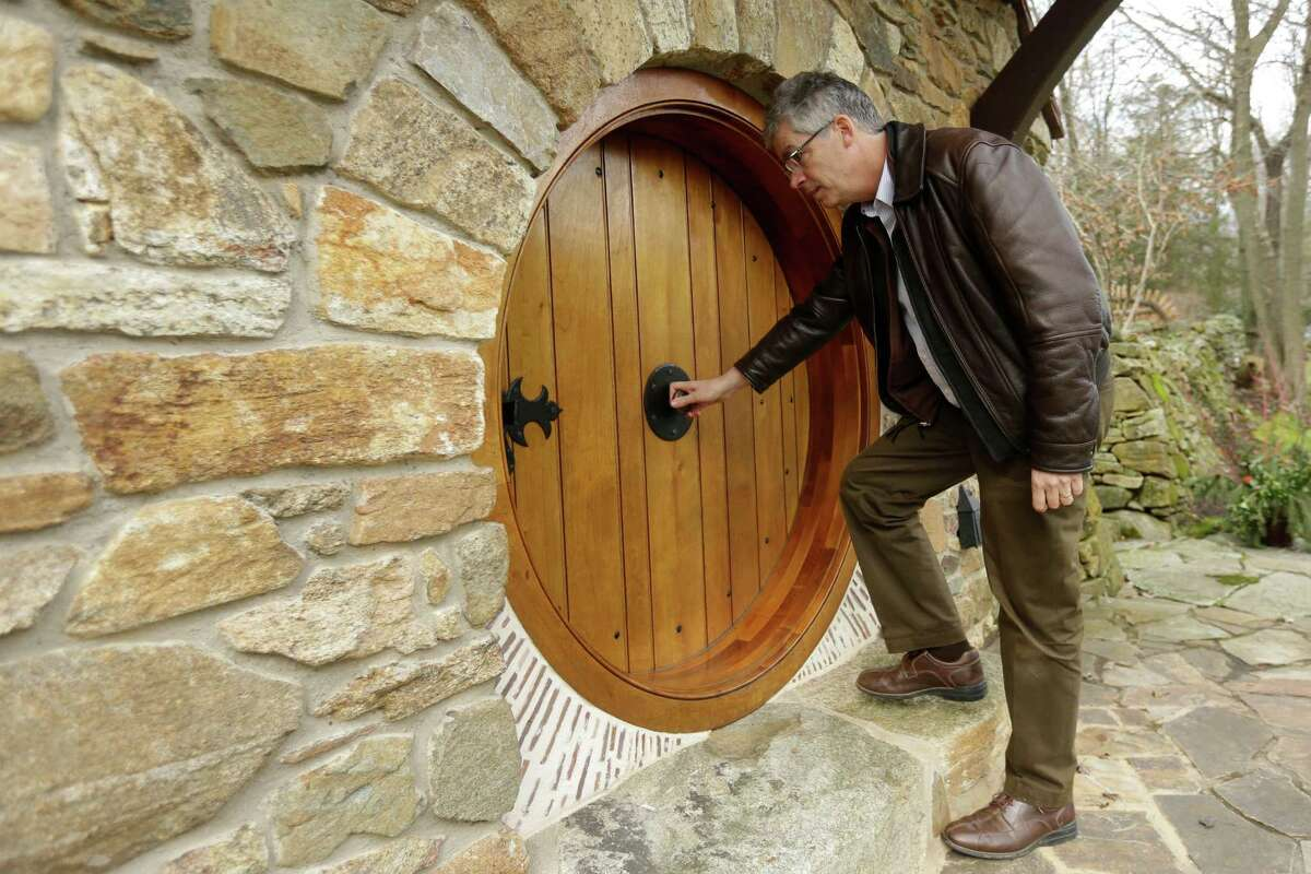 """Architect Peter Archer enters the """"Hobbit House"""" during and interview with the Associated Press Tuesday, Dec. 11, 2012, in Chester County, near Philadelphia. Archer has designed a """"Hobbit House"""" containing a world-class collection of J.R.R. Tolkien manuscripts and memorabilia."""