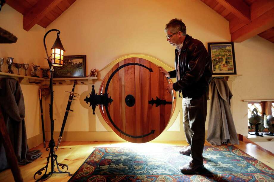 "Architect Peter Archer closes the front door of the ""Hobbit House"" during and interview with the Associated Press Tuesday, Dec. 11, 2012, in Chester County, near Philadelphia.  Archer has designed a ""Hobbit House"" containing a world-class collection of J.R.R. Tolkien manuscripts and memorabilia. Photo: Matt Rourke, AP / AP"