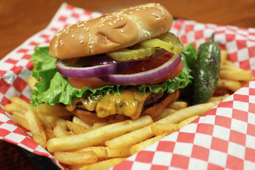 Bently's, 1725 Blanco Road: A small menu that's done right. Juicy burgers, excellent onion rings and nice beer selection in a relaxing neighborhood setting. Photo: Juanito M Garza, San Antonio Express-News / San Antonio Express-News