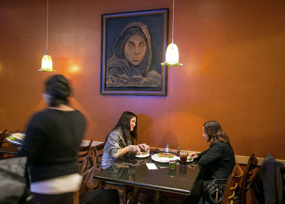 Diners enjoy dinner at De Afghanan. Photo: John Storey, Special To The Chronicle / John Storey