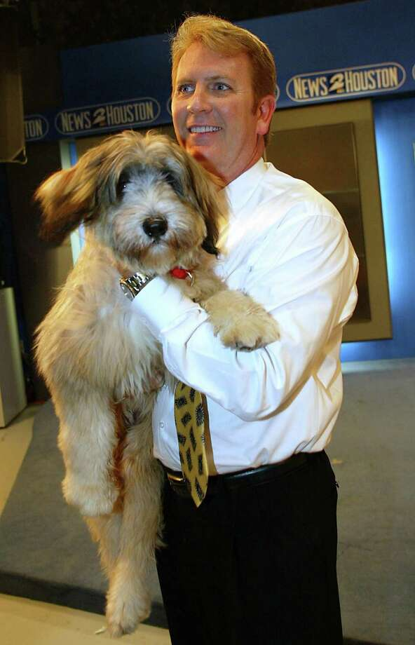 Chief Meteorologist  Frank Billingsley with KPRC Channel 2's weather dog Radar in 2004. Photo: James Nielsen, Special To The Chronicle / Freelance