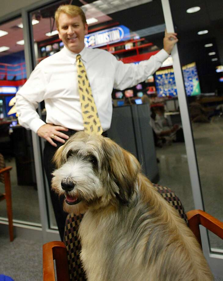 Chief Meteorologist  Frank Billingsley with KPRC's weather dog Radar in 2004.  Photo: James Nielsen, Special To The Chronicle / Freelance