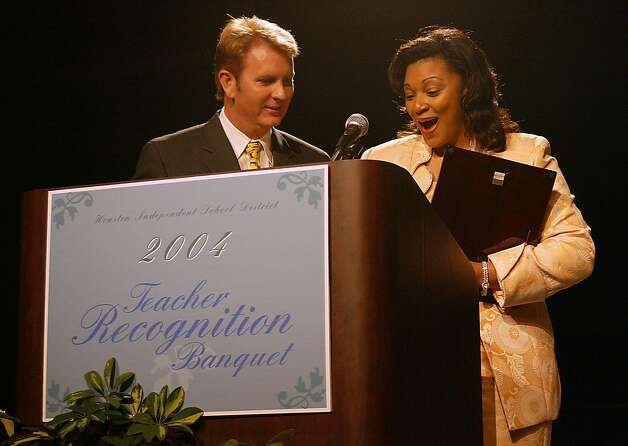 Anderson Elementary School's Carla Jones Tucker receives a certificate from Frank Billingsley as she is awarded the 2004 HISD Elementary Teacher of the Year.  Photo: James Nielsen, Special To The Chronicle / James Nielsen