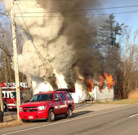 A fire at 2042 Route 9 in Clifton Park, N.Y., destroyed a residence adjacent to a business. (Reader submitted photo)