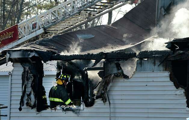 Fire Investigators from Saratoga County start an investigation as to the cause and origin of a fire that consumed a building on Route 9 in Jonesville, N.Y. Dec 13, 2012.   (Skip Dickstein/Times Union) Photo: SKIP DICKSTEIN