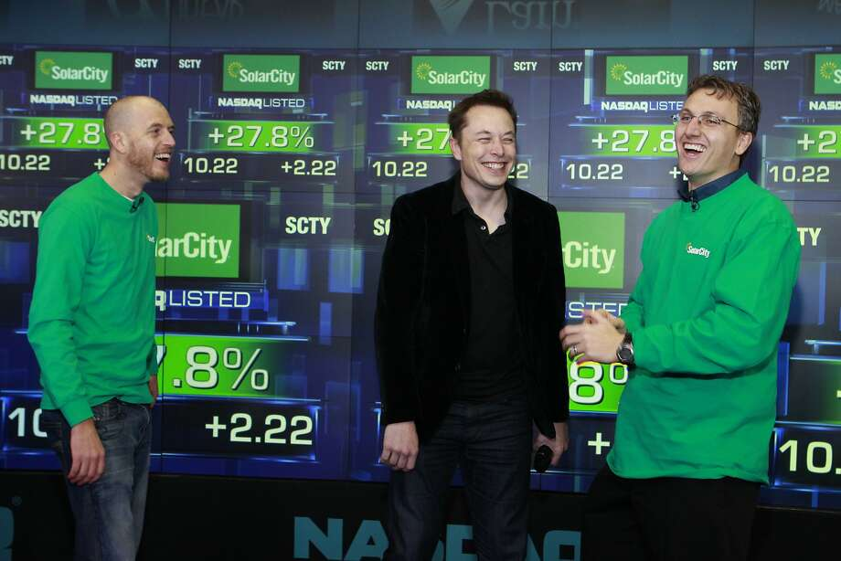 SolarCity co-founder Peter Rive (left), Chairman Elon Musk and CEO Lyndon Rive mark the IPO. Photo: Mark Von Holden, Associated Press