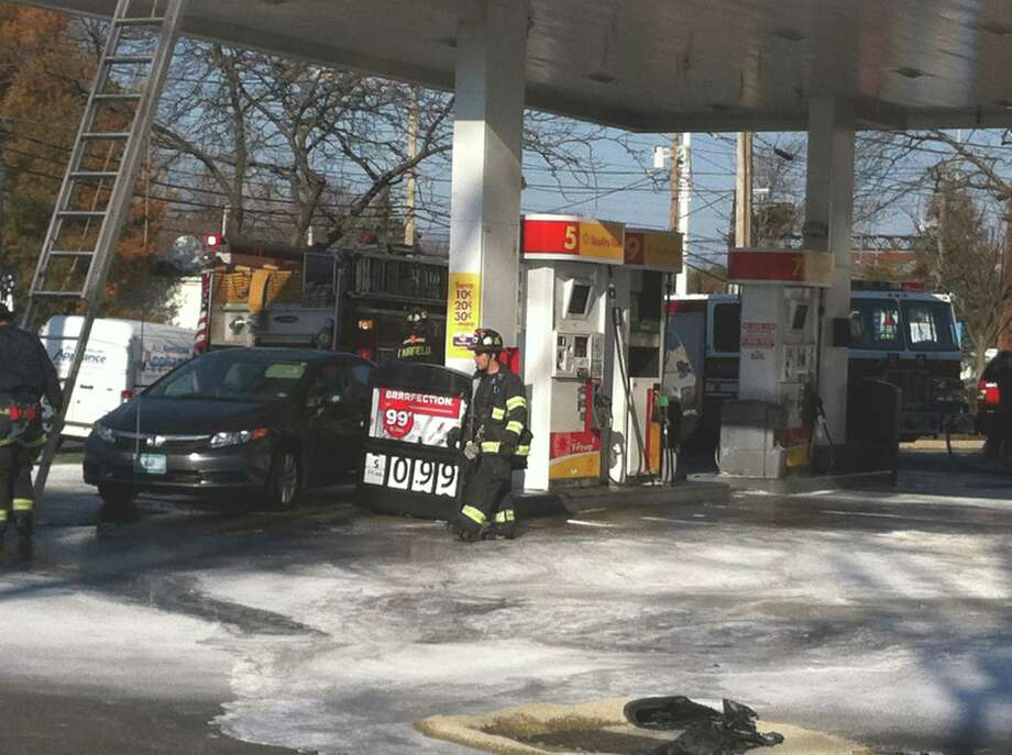White fire-retardant power sprayed down on the gas pumps when the fire-suppression system malfunctioned at the Shell station on the Post Road Thursday afternoon. Fairfield CT 12/13/12 Photo: Genevieve Reilly / Fairfield Citizen