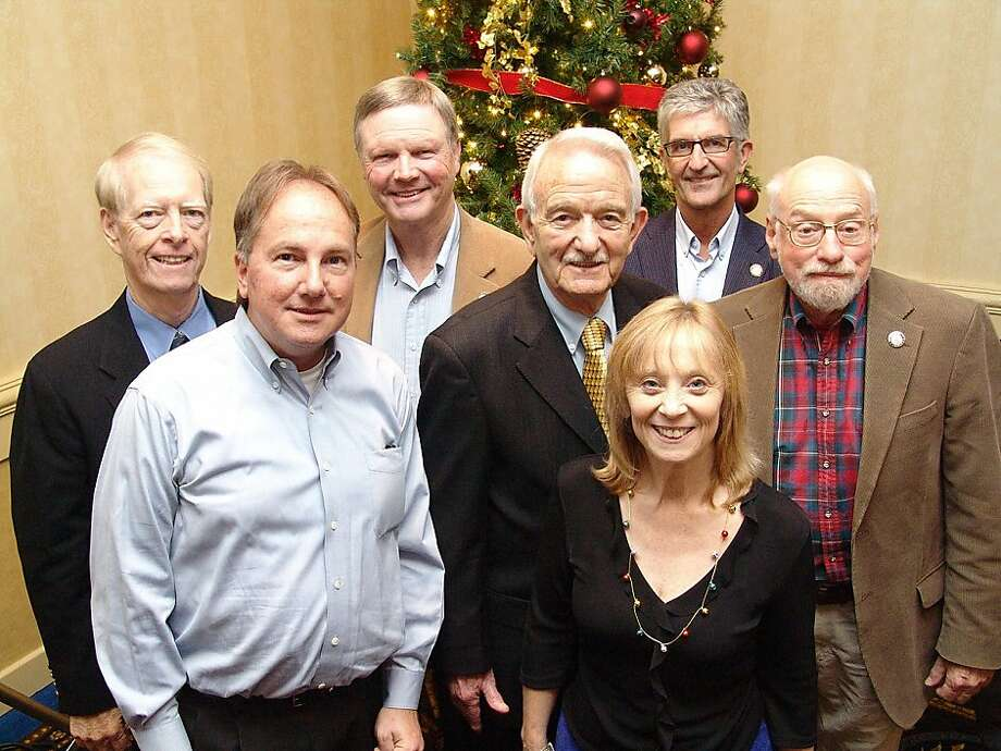Faces from the poem (from left): Joe Starkey, David F. Jackson, Hal Ramey, Bob Safford, Trish Bell, Stan Bunger and Tom Saunders at the Broadcast Legends' holiday luncheon. Photo: Robert Mohr, Stock Options