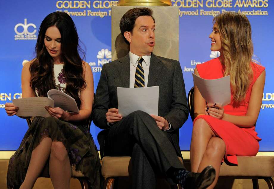 Presenters Ed Helms, center, and Jessica Alba, right, mingle as fellow presenter Megan Fox studies her script before the announcement of nominations for the 70th Annual Golden Globe Awards, Thursday, Dec. 13, 2012, in Beverly Hills, Calif. The Golden Globe Awards will be held on Sunday, Jan. 13 at the Beverly Hilton Hotel in Beverly Hills. (Photo by Chris Pizzello/Invision/AP) Photo: Chris Pizzello