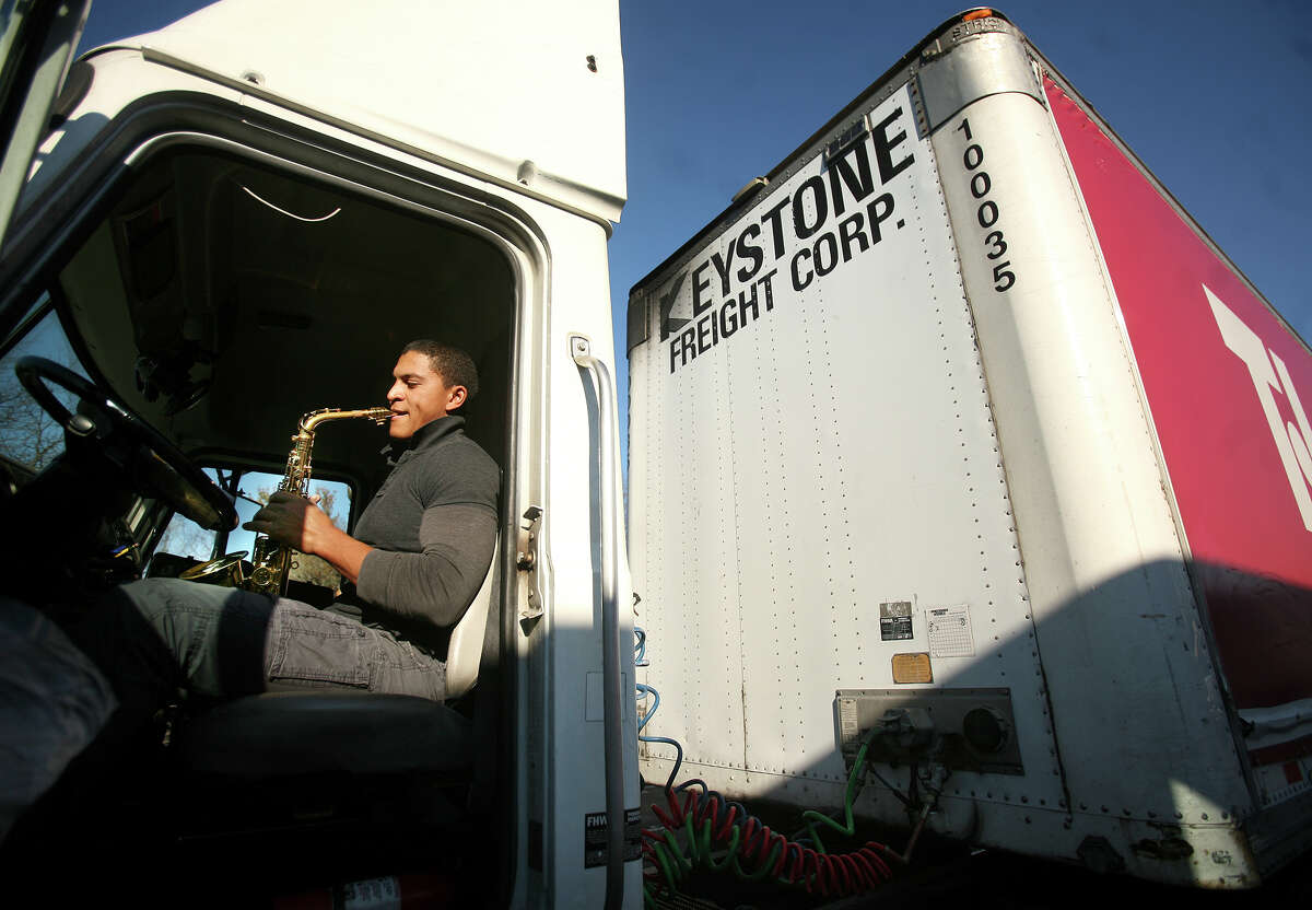 Truck driver Eli Nin of Passaic, NJ, practices his saxophone while parked in the truck parking area at the I-95 southbound rest stop in Fairfield on Thursday, December 13, 2012. Nin said that Connecticut's rest stop situation is better than others in the tri-state region surrounding New York City.