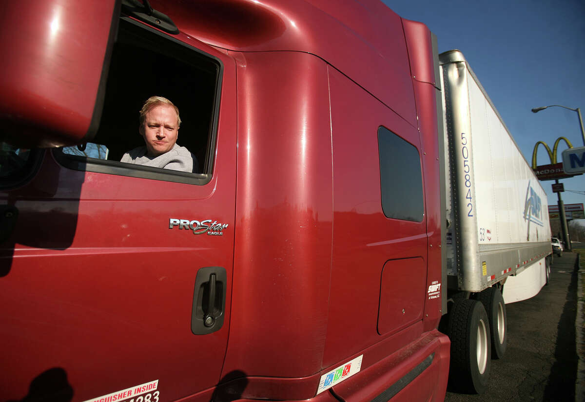 Swift Transportation truck driver Evan Omdahl parks illegally on the shoulder as he eats his breakfast at the southbound I-95 rest stop in Fairfield on Thursday, December 13, 2012. A fatality occurred when a car crashed into a parked truck in the same location on Wednesday night.