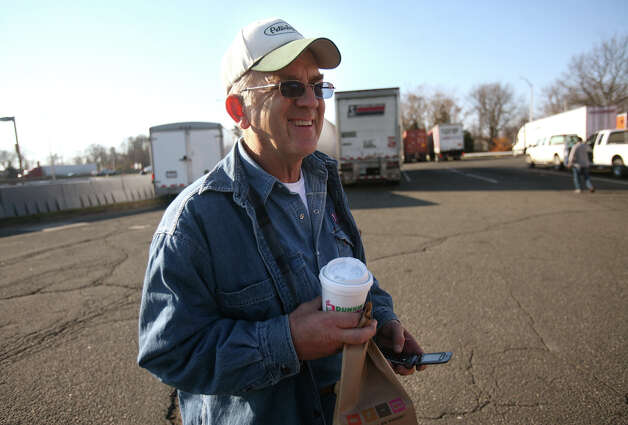 Truck driver Gene Stoms of Elmer, NJ, stops for a coffee and some breakfast at the I-95 southbound rest stop in Fairfield on Thursday, December 13, 2012. The rest stop was the site of a fatality on Wednesday night when a car crashed into a parked truck. Photo: Brian A. Pounds / Connecticut Post