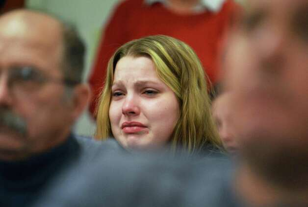 Alicia Berg, daughter of victim Tammy Palmer, reacts as Steven McComsey, who pleaded guilty last month to one count of negligent homicide for a house blast that killed six, is sentenced in Washington County Court Thursday Dec. 13, 2012.  (John Carl D'Annibale / Times Union) Photo: John Carl D'Annibale / 00020427A