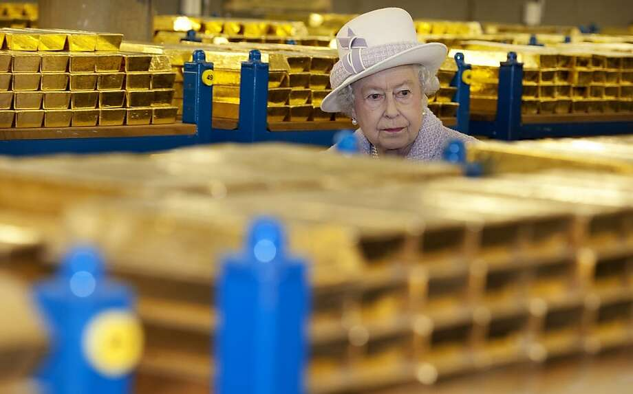 Her Majesty likes to check her 'safety deposit box' from time to time:Queen Elizabeth II inspects gold reserves in a vault at the Bank of England in London. Photo: Eddie Mulholland, AFP/Getty Images